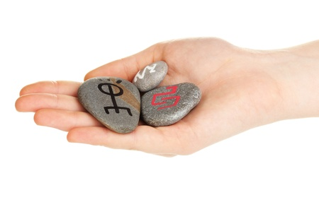 Fortune telling  with symbols on stone in hand isolated on white Stock Photo - 19784621
