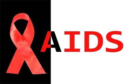 Aids awareness red ribbon isolated on black with aids word photo