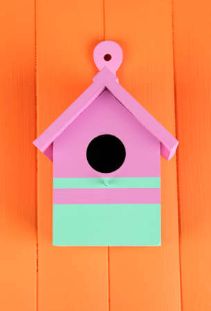 Decorative nesting box on color wooden background photo