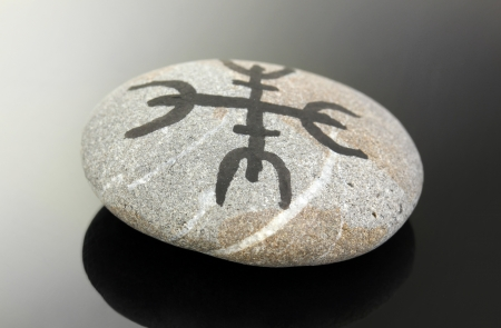 Fortune telling  with symbols on stone on black background Stock Photo - 19892623