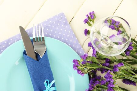 Table serving on a wooden background photo