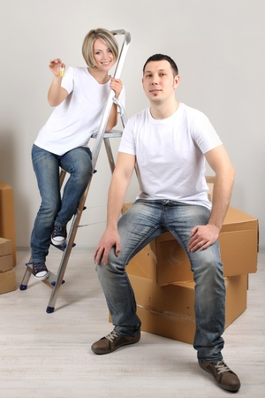 Young couple moving in new house Stock Photo - 21525044
