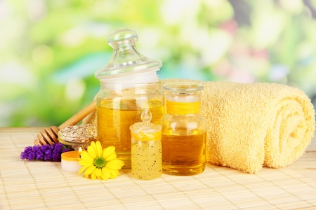humidify: Fragrant honey spa with oils and honey on wooden table on natural background
