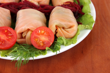 Stuffed cabbage rolls on table close-up photo