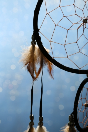 dream catcher: Beautiful dream catcher on blue background with lights Stock Photo