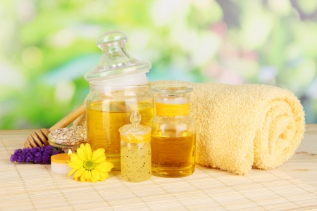fragrant: Fragrant honey spa with oils and honey on wooden table on natural background