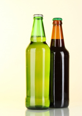 Bottles of beer on light background photo