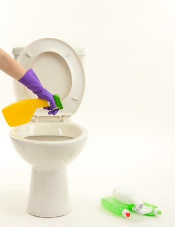 Woman hand with spray bottle cleaning a toilet bowl, isolated on white Stock Photo - 19972181