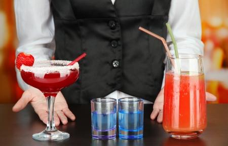 barmen: Barmen making tasty cocktails, on bright background
