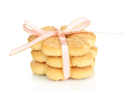 Sweet cookies tied with pink ribbon isolated on white photo