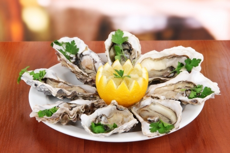 sea food: Oysters on table in cafe Stock Photo