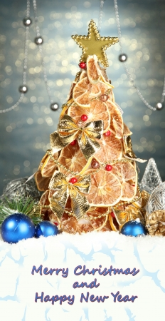 Beautiful Christmas tree of dry lemons with decor photo