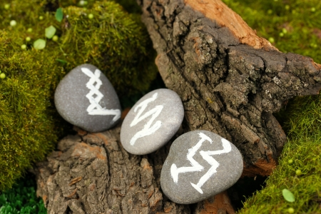 occultism: Fortune telling  with symbols on stone close up