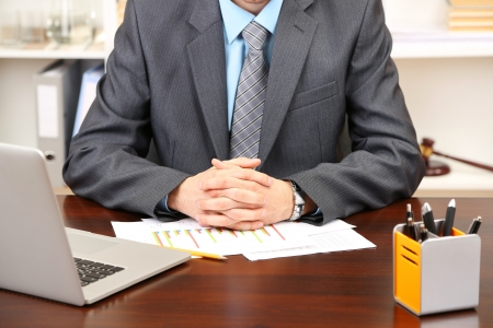 Young businessman in office at his workplace Stock Photo - 20041704