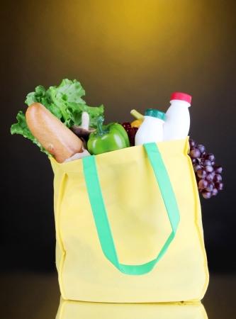 pone: Eco bag with shopping on dark orange background Stock Photo