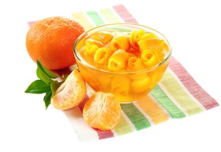 sweet segments: Orange jam with zest and tangerines, isolated on white