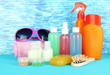 Hotel cosmetics kit on bright color background photo