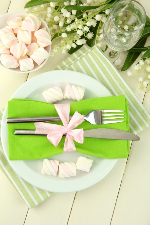 Table setting in white and green tones on color  wooden background Stock Photo - 20126146