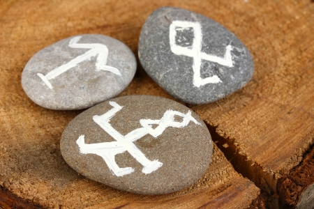 Fortune telling  with symbols on stones on wooden background Stock Photo - 20126185
