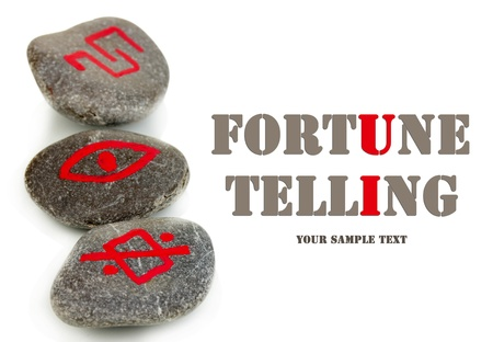 Fortune telling  with symbols on stones isolated on white photo