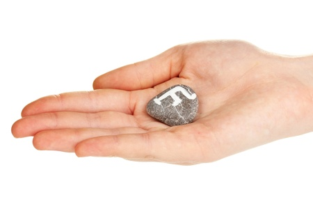 Fortune telling  with symbols on stone in hand isolated on white Stock Photo - 20123869