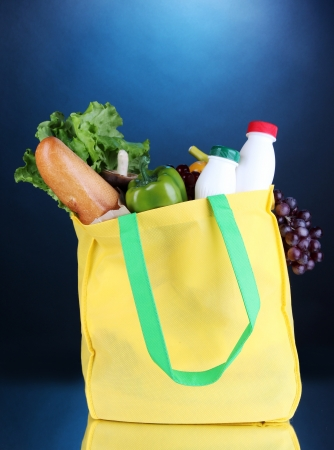 pone: Eco bag with shopping on dark blue background