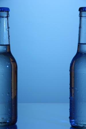 Water bottles on blue background photo