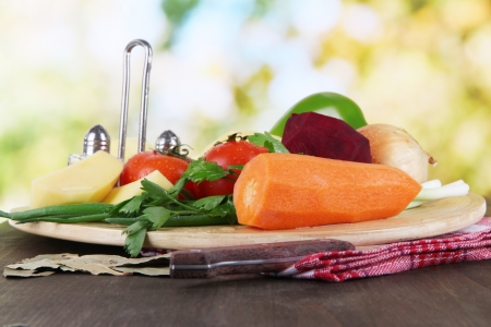 Composition of vegetables on bright background photo