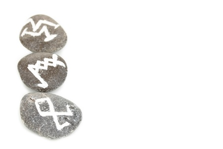 Fortune telling  with symbols on stones isolated on white Stock Photo - 20146975