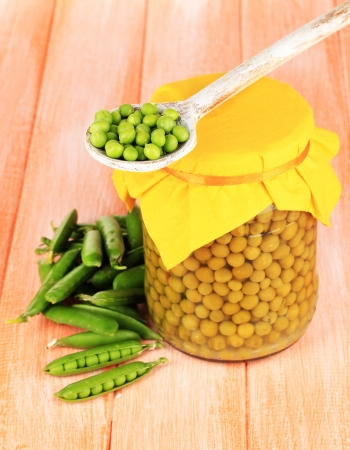 Green peas on wooden background photo