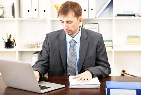 Young businessman in office at his workplace Stock Photo - 21525704