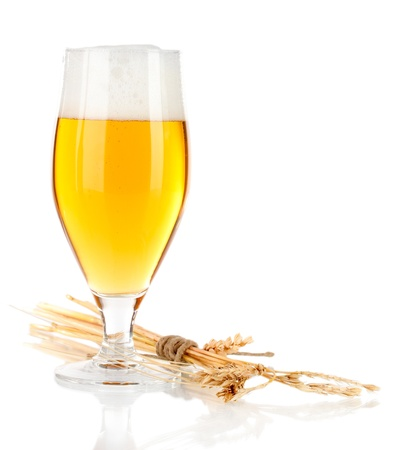 lets: Glass of beer with spike lets on light yellow background Stock Photo
