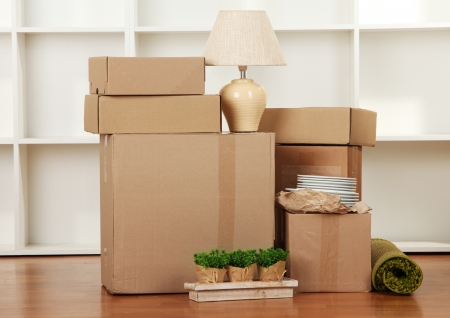 cardboard house: Moving boxes in empty room Stock Photo