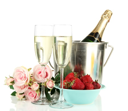 Romantic still life with champagne, strawberry and pink roses, isolated on white photo
