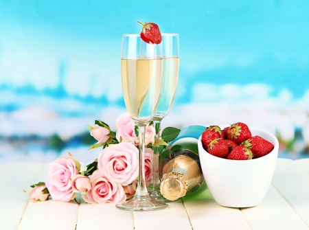 Romantic still life with champagne, strawberry and pink roses, on bright background photo