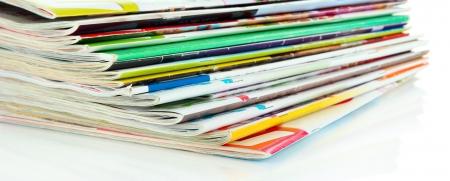 media distribution: Many magazines isolated on white