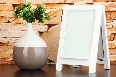 White photo frame for home decoration on stone wall background photo