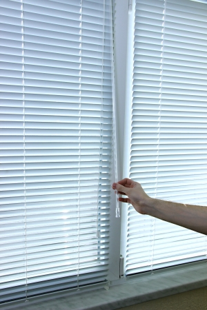 housing lot: Someone opens blinds