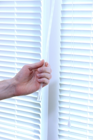 Someone opens blinds Stock Photo - 20213694