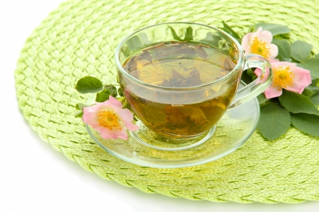 Cup of herbal tea with hip rose flowers, isolated on white photo
