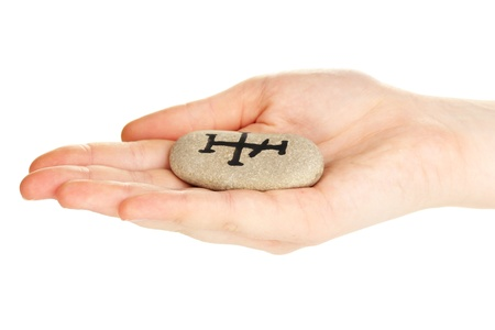 Fortune telling  with symbols on stone in hand isolated on white Stock Photo - 20251150