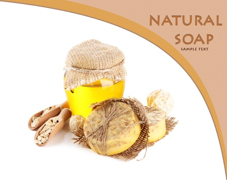 Hand made soap and ingredients for soap making, isolated on white photo