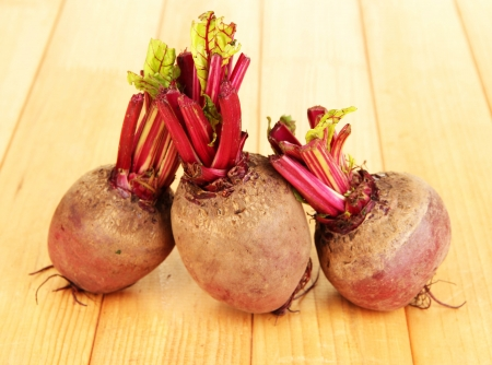Young beets on wooden table close-up photo