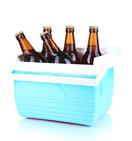 Traveling refrigerator with beer bottles isolated on white photo