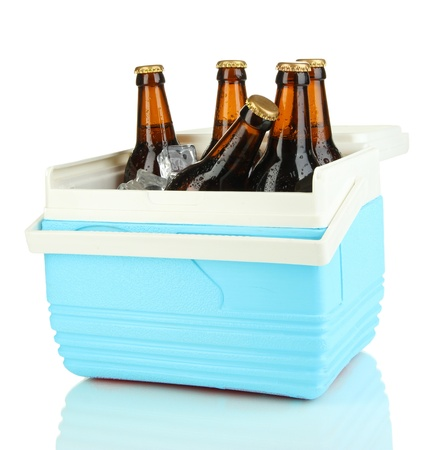 chiller: Traveling refrigerator with beer bottles and ice cubes isolated on white Stock Photo