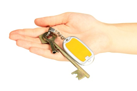 Keychain with house keys in hand  isolated on white photo