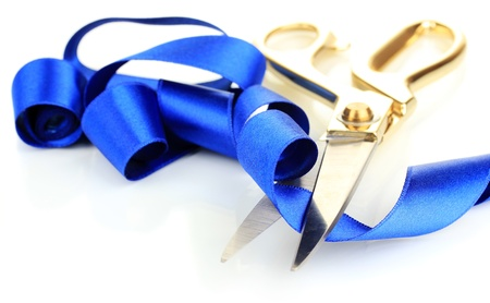 satin ribbon: Satin ribbon curled around scissors isolated on white