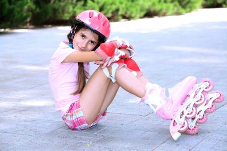 skate park: Little girl in roller skates at  park Stock Photo