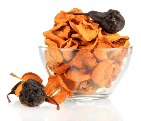 Assorted dried fruits in glass bowl isolated on white photo