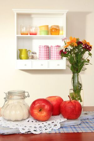 Kitchen composition on table on shelf background photo